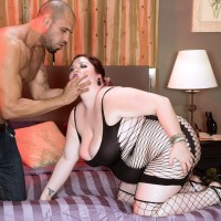 ginger-haired BBW Trinety Guess dirty dances her ass in a revealing sundress while seducing a boy