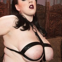 BIG HOT WOMAN Goth Kamille Amora puts her large boobs on display in a restrain bondage harness
