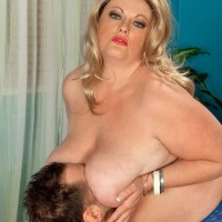Platinum-blonde BIG SEXY LADY Brianna Falcone boob strangles her stud before coochie licking and sexual intercourse