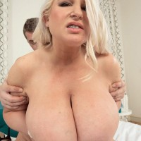 Light-haired BIG HOT LADY Samantha Sanders showcases her hefty titties while getting fucked on a bed