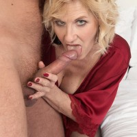 Platinum-blonde cougar Molly Maracas licks her younger lover's dick after he brings her wine