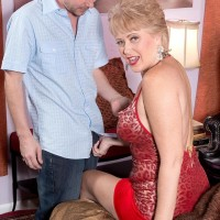 Gorgeous older dame Tracy Slurp is freed from a tight sundress before having her erect nips sucked