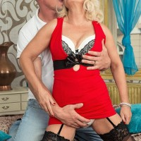 Older fair-haired broad Coco de Marq is freed from a red dress before sex with her younger lover