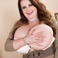 Fat ginger-haired Anna Beck exposes her giants breasts from a dress afore a mirror