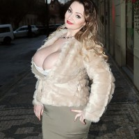 Killer MILF Micky Bells sets her gigantic titties free off a tight fitting sundress during solo action