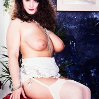 Chubber solo model Justine sets her huge tits loose from a sundress while garmented white hosiery