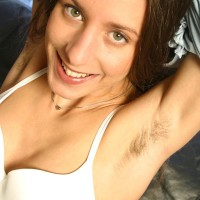 Amateur solo chick stretches her all-natural cooter while modelling on a ebony leather sofa
