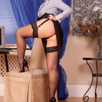 Elder ginger-haired first timer reveals her ass and cootchie in glasses with hosiery and garters