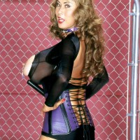 Solo female Minka flashes off her enormous boobies in a cupless body-suit and a waistline cincher