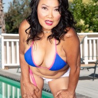 60 Plus Asian MILF Mandy Thai removes a cable swimsuit to get naked by a pool
