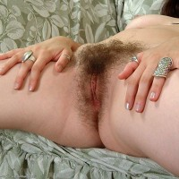 Amateur Euro females unbutton and show off their naturally hairy pussies