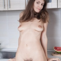 First-timer model Shivali munches a watermelon while showing her hairy pits and snatch