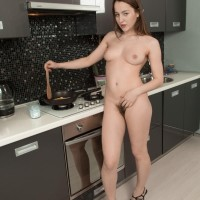 Amateur stunner Yana Cey opens up her utter pubic hair after getting nude in the kitchen