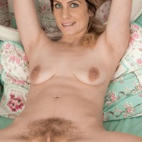 Barefoot first-timer Ashleigh McKenzie spreads her legs to play with her total pubic hair