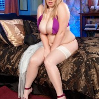 BBW Fate Rose unleashes her excellent titties from a bras attired a thong and nylons