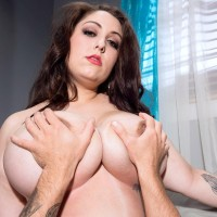 Gorgeous plus-size female Allie Pearson boob strangling dude with her monster-sized breasts