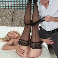 Immense jugged blond MILF Holly Claus delivering massive cock blowjobs in black nylons