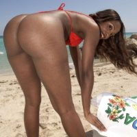 Black solo chick Sapphira flaunting enormous butt on beach clad crimson swimsuit