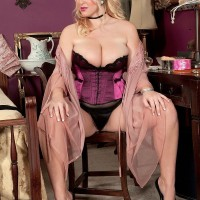 Golden-haired MILF Rockell bares her big tits in fantastic lingerie before donning tights