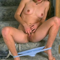 Brown-haired first-timer showing off unshaven pits and vagina in milky nylons