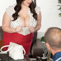 Dark-haired BIG HOT LADY Angel DeLuca having her gigantic boobs exposed while getting disrobed naked
