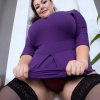 Brown-haired BIG SEXY LADY Mariya Mills letting large flappy titties loose from sundress and boulder-holder in nylons