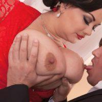 Dark-haired BIG SEXY WOMAN Nila Mason extracting huge boobies before giving BLOW-JOB in hosiery