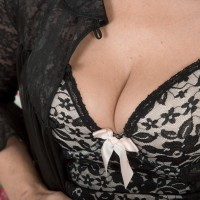 Dark-haired MILF Kaysy exposing diminutive boobies and wide open cootchie from seductive lingerie