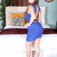Brunette MILF Vanessa Luna flashing huge booty and tats before unleashing immense tits
