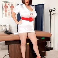 Brunette nurse Elaina Gregory flashing her huge bum and fur covered muff in uniform