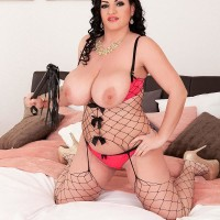 Black-haired solo chick Juliana Simms releasing giant all natural funbags from lingerie