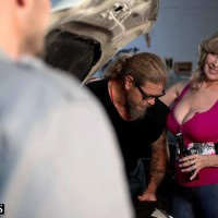 Huge-chested blonde cougar Laura Layne seducing mechanics for MMF 3some in garage