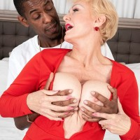 Huge-titted sandy-haired grandma Seka Black holds a Voyeurism Tom's BBC in her hand