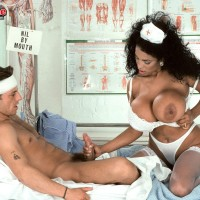 Big-chested ebony nurse Angelique entices a masculine patient during upskirt activity on a bed
