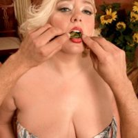 Plump ash-blonde chick Daphne Carter letting giant tits loose while eating food and giving BLOW-JOB