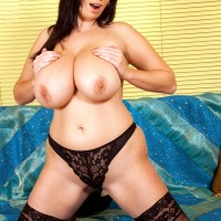 Chubby brunette MILF uncovering fun bags before stuffing faux-cock into pussy in tights