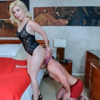 Fully-clothed golden-haired Inga Victoria has her ass sniffed by her girlfriend's sub