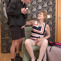 Fully-clothed aged doll Georgina seducing bike courier with a blow-job in nylons