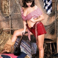 Dark haired farm female Carrie sets her gigantic boobies free in leather boots and cut-offs