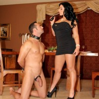 Black-haired girlfriend Bella Reese makes her masculine slave lick out her anus in pumps