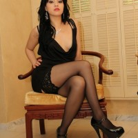 Dark-haired girlfriend Chloe Cain dominates her naked husband before posing in hosiery