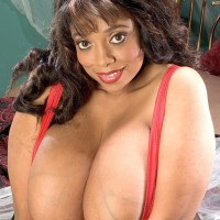 Ebony BIG HOT WOMAN Bunny Michelle bares her humungous boobs from a corset during solo act