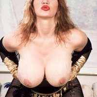 Famous X-rated actress Ashley Burst discards her humungous titties from crotchless bodystocking