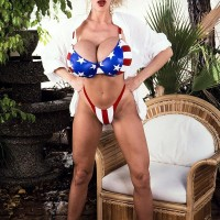 Famous X-rated starlet Pandora Peaks whips out her monster-sized breasts from a USA themed bikini