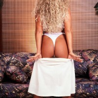 Well-known adult vid starlet Taylor Marie whips out her immense breasts in a white dress and lingerie