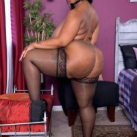 Plus-size ebony solo female Virgin Blossoms flaunting huge arse in hose and lingerie