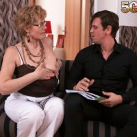 Granny in glasses tempts a younger dude and bj's his cock on sofa