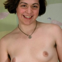 Hirsute Euro amateur with pierced hard nipples stripping to pose in the naked