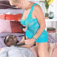 Dirty grannie Tracy Gobbles tempts a junior black man by flashing her hefty all natural boobs