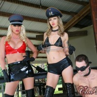 Hot golden-haired Cherry Morgan and another brutish babe stomp a naked stud with long boots